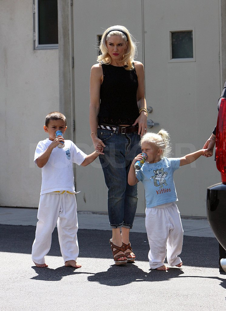 Gwen Stefani holds her sons' hands.