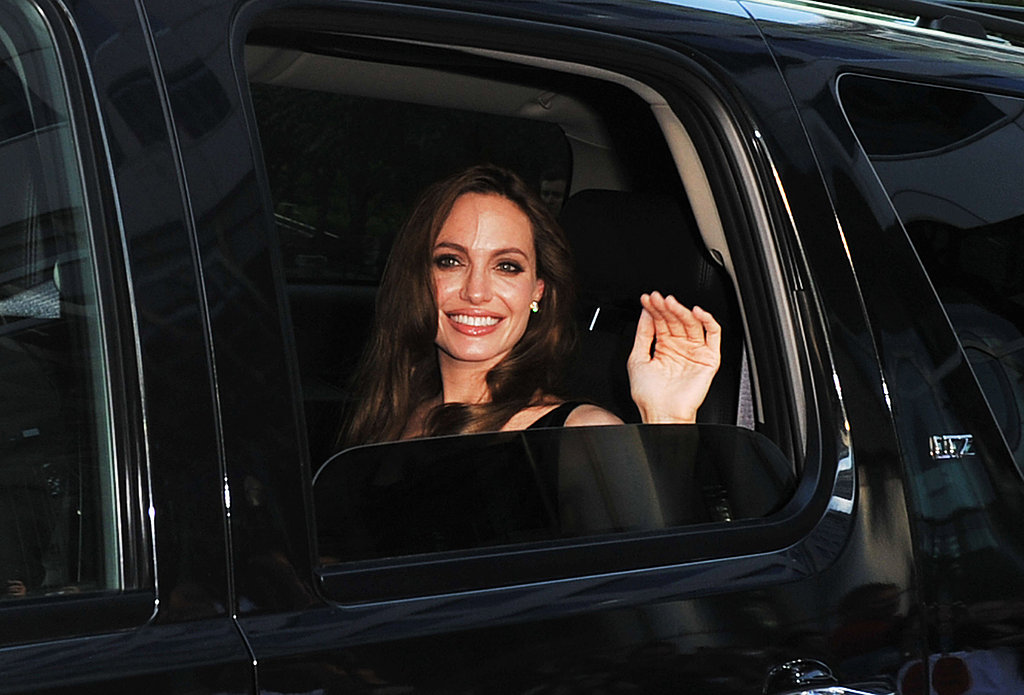 Angelina Jolie waved to fans from her car.