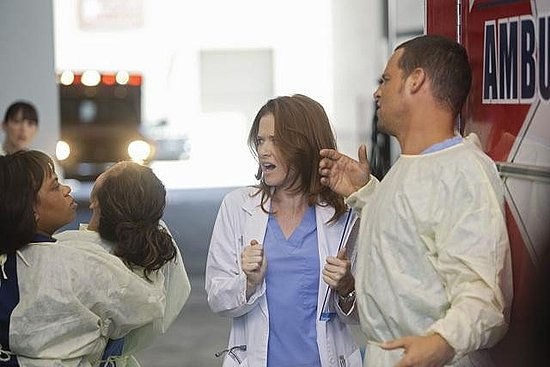 Sarah Drew as Dr. April Kepner, Sandra Oh as Dr. Cristina Yang, Justin Chambers as Dr. Alex Karev, and Chandra Wilson as Dr. Miranda Bailey on Grey's Anatomy. Photo copyright 2011 ABC, Inc.