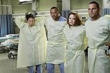 Sarah Drew as Dr. April Kepner, Justin Chambers as Dr. Alex Karev, Jesse Williams as Dr. Jackson Avery, and Sandra Oh as Dr. Cristina Yang on Grey's Anatomy.  Photo copyright 2011 ABC, Inc.