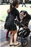 Victoria Beckham picked Harper up out of her black stroller.