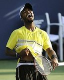 Donald Young flashes his abs after beating Stanislas Wawrinka of Switzerland on Friday.