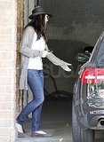 Sandra Bullock hops in her car.