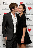 Elliott Tittensor smooches a beaming Kaya Scodelario at the 68th Venice Film Festival.