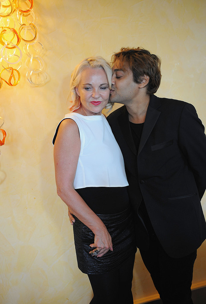 Pablo Ganguli smooches Amanda Eliasch at the Venice International Film Festival luncheon and panel.