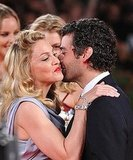 Film director Madonna kisses Oscar Isaac at the screening of her film W.E..