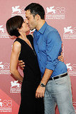 Filippo Timi and Claudia Pandolfi share an intimate moment at the photo call for Quando la Notte.