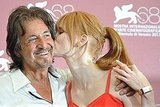 Al Pacino embraces Jessica Chastain as she kisses him during the Wilde Salome photo call.