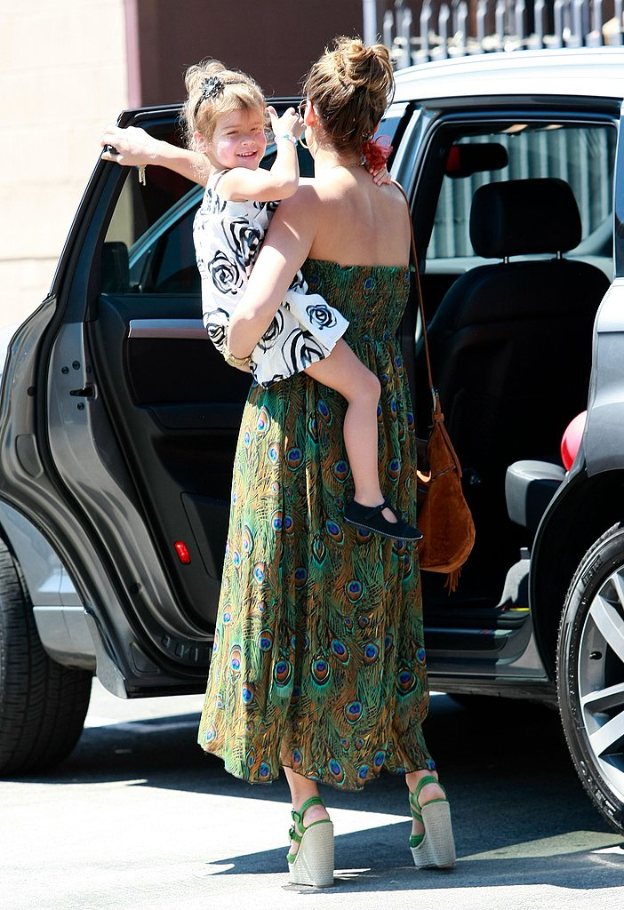 Honor Warren flashed a thumbs up as Jessica Alba helped her out of the car.