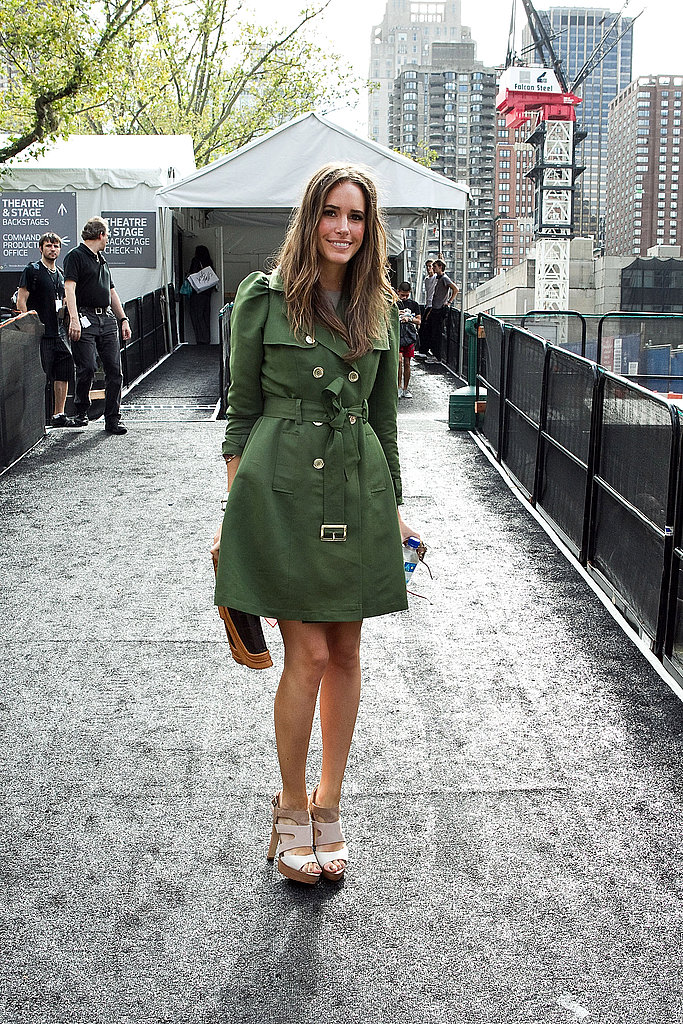 Louise Roe looked chic in a green trench coat and platform sandals.