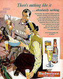 """Wind howling, logs crackling, popcorn popping, Budweiser sparkling,"" reads the copy of this 1950 ad featuring a young couple. Both the man and the woman are casually enjoying a cool glass of bud on a presumably colder day."