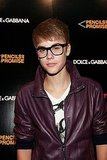 Justin Bieber in purple leather.