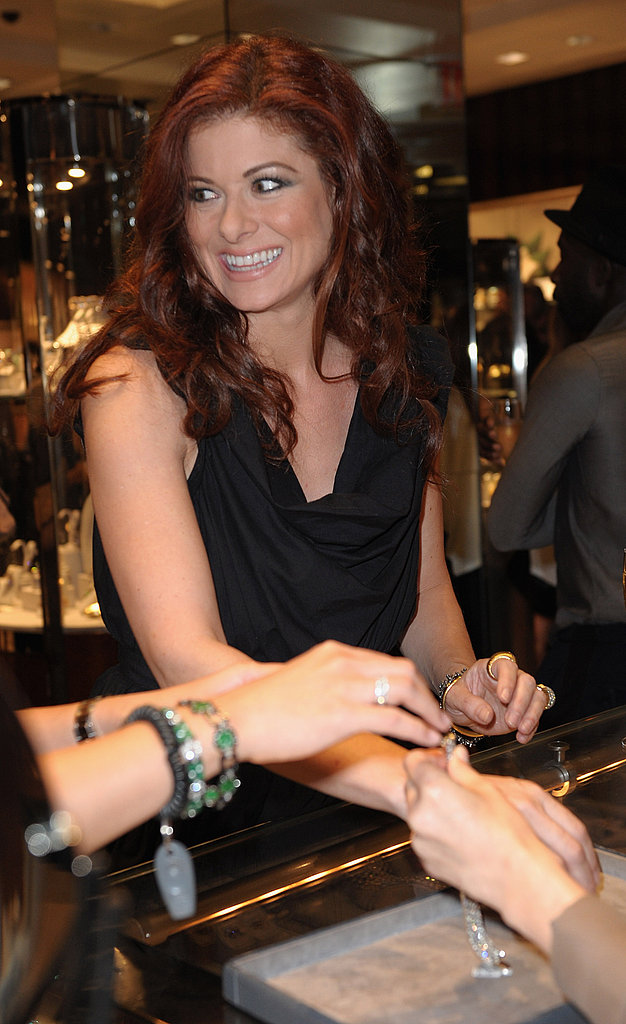 Debra Messing smiled on Fashion's Night Out.