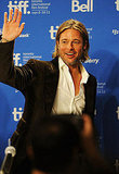 Brad Pitt waved to the crowd at the Moneyball press conference.