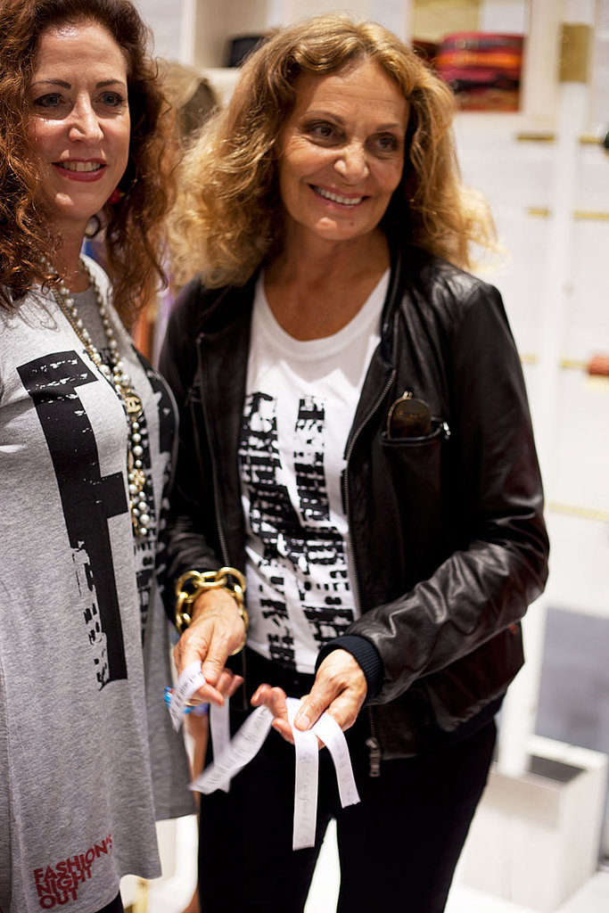 Diane and a fan posing in their FNO tees.