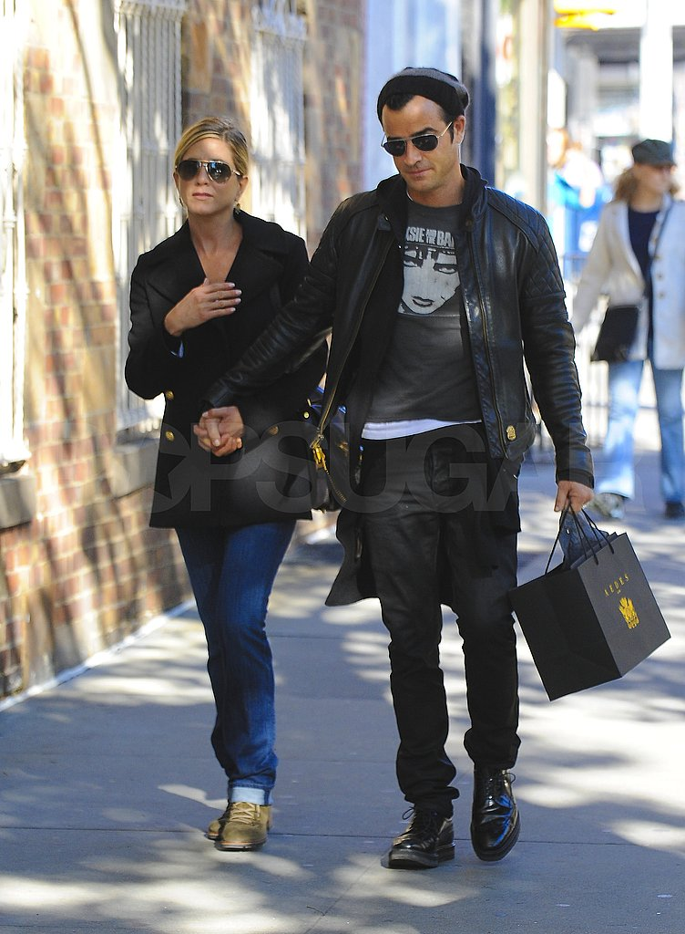Jennifer Aniston and Justin Theroux wear black.