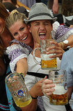 A couple shows love for each other and their beer at Oktoberfest.