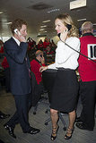 Prince Harry and Eva Herzigova kept their eyes on the trading boards.