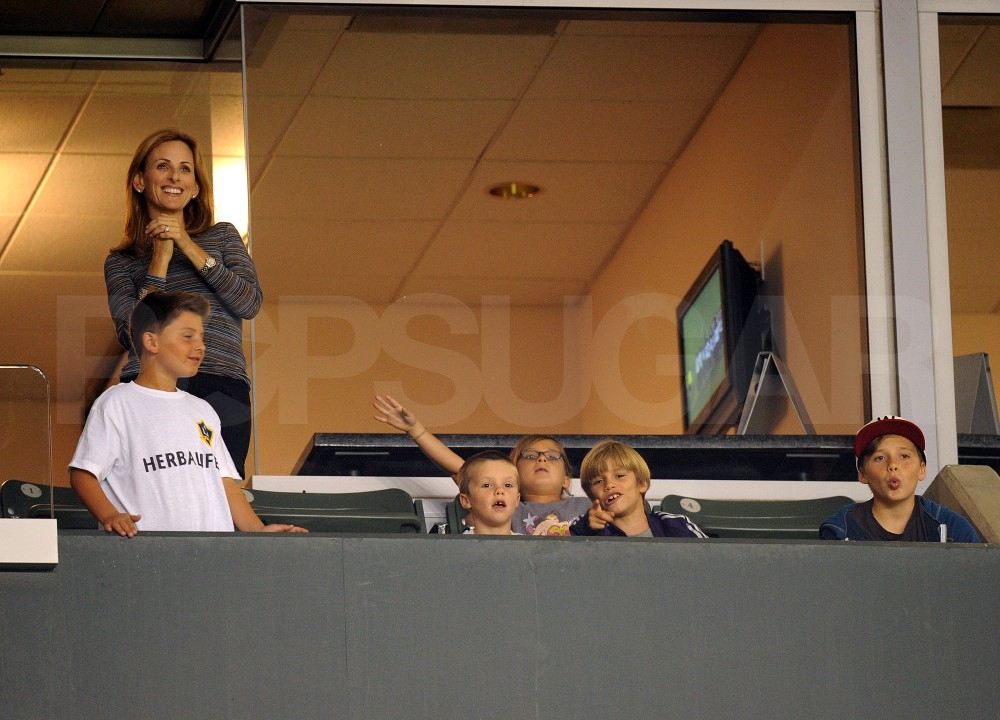 Cruz, Brooklyn, and Romeo Beckham cheered from the stands.