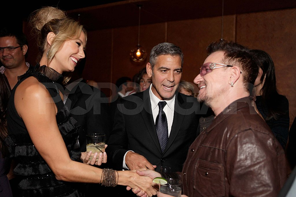 George Clooney and Stacy Keibler with Bono at TIFF.