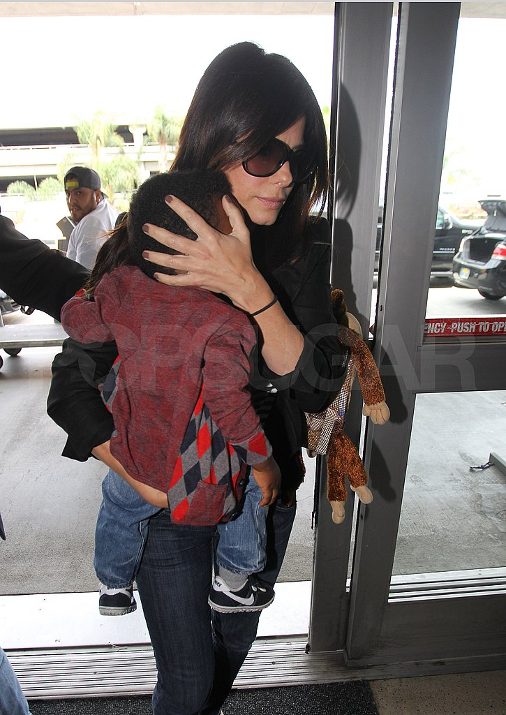 Sandra Bullock took Louis on a flight.