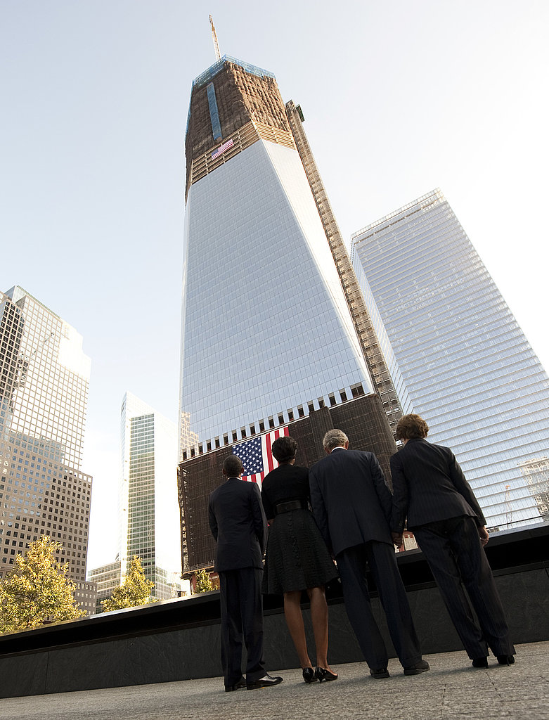 President Barack Obama, First Lady Michelle Obama, former President George W. Bush, and former First Lady Laura Bush stand at the memorial wall on the North Tower reflecting pool of the World Trade Center on the 10-year anniversary of the 9/11 attacks.