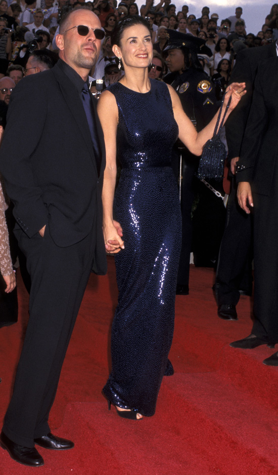 Bruce Willis and Demi Moore arrived hand in hand to the 1997 show.