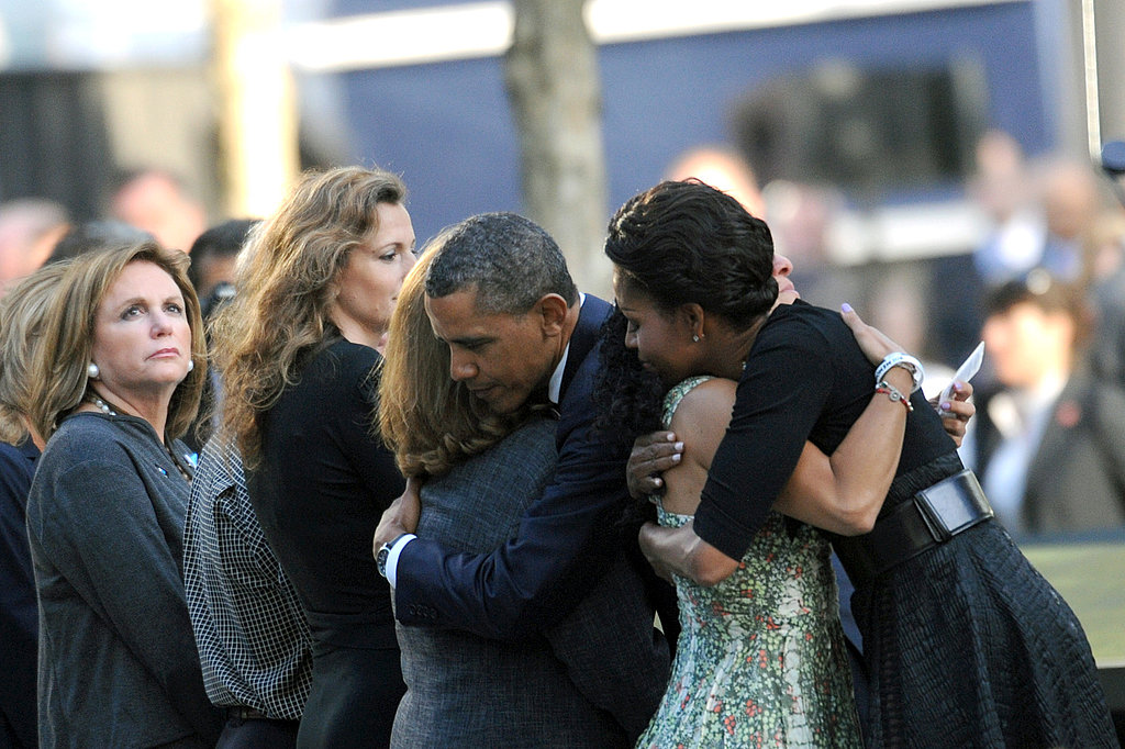 President Barack Obama and First Lady Michelle Obama embrace mourners at the World Trade Center site.