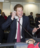 Prince Harry laughs on the phone.