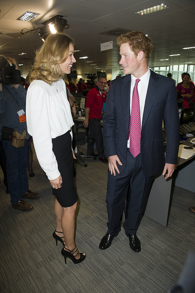 Prince Harry talks with supermodel Eva Herzigova at the charity event.