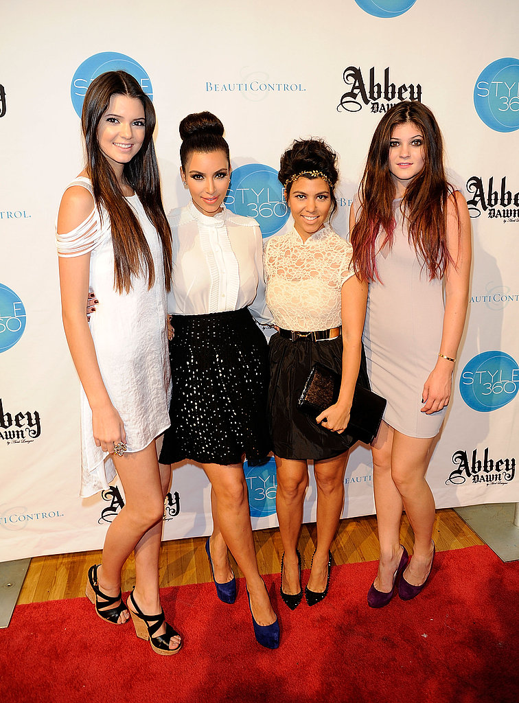 Kendall Jenner, Kim Kardashian, Kourtney Kardashian, and Kylie Jenner attend the Abbey Dawn by Avril Lavigne Spring 2012 fashion show.