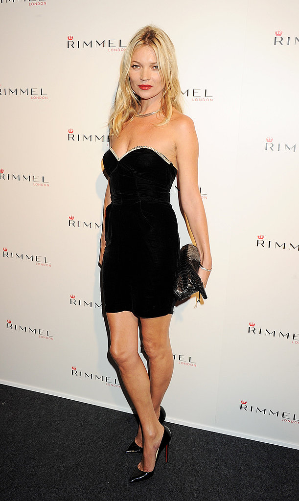 Kate Moss in a black dress at a Rimmel London party.