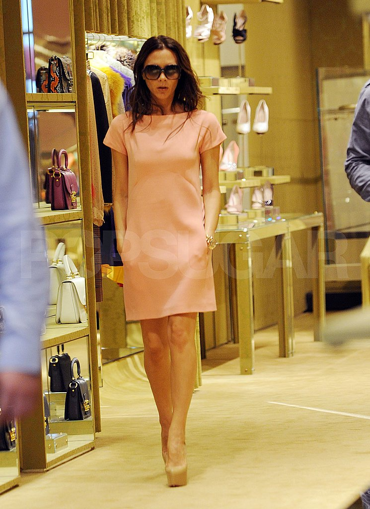 Victoria Beckham browses for more shoes at Christian Louboutin.
