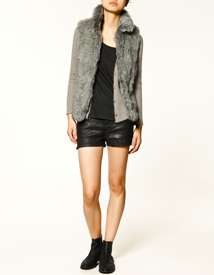 We love the soft gray hue and super affordable price tag. Zara Sheepskin Gilet ($80)