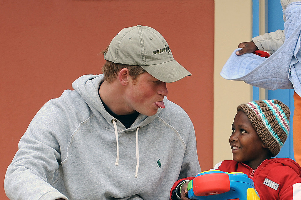 Harry sticks out his tongue at a boy during a visit to the Lesotho Child Counseling Unit in 2008.