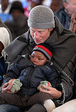 Harry holds a boy during a visit to a child education center in Semonkong, Lesotho, last year.