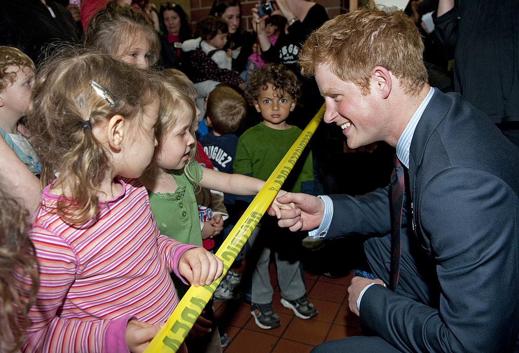 Prince Harry meets children at the Veterans Administration Healthcare center during his 2009 visit to NYC.