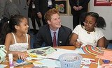 Harry does crafts with children at the Harlem Children's Zone during his 2009 visit to New York.