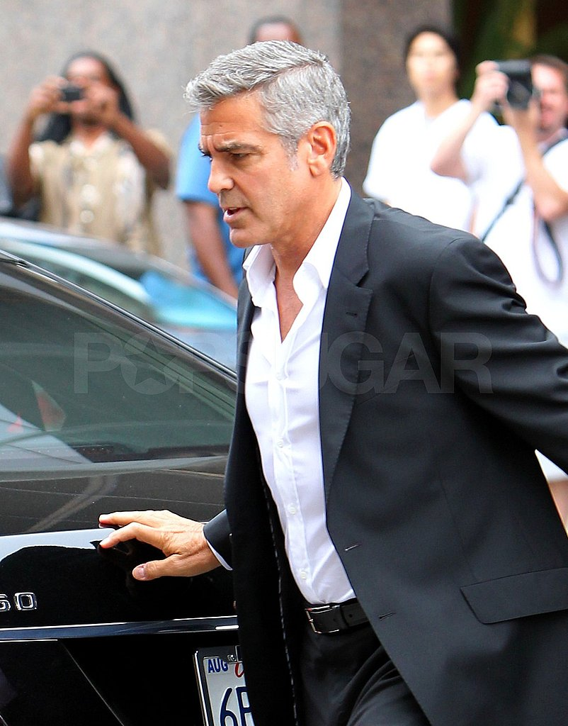 Spectators snapped photos of Mr. Clooney at work.