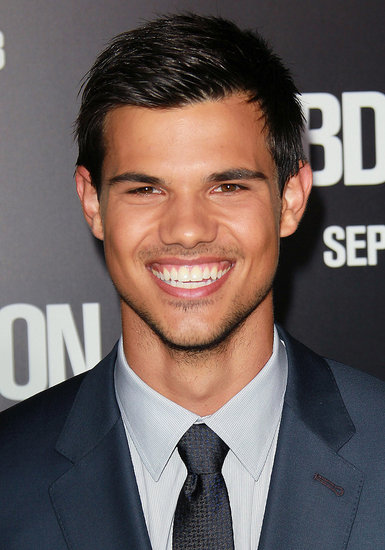 Taylor Lautner flashed a movie-star smile.