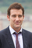 Clive Owen smiles in San Sebastian.