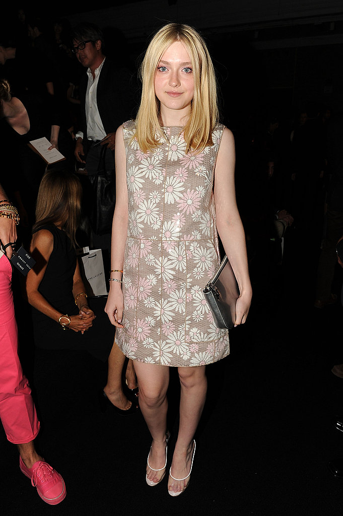 Dakota Fanning at the Marc Jacobs show in a daisy print dress from the designer.
