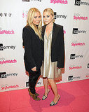 Mary-Kate and Ashley Olsen in black and gold at Fashion's Night Out.