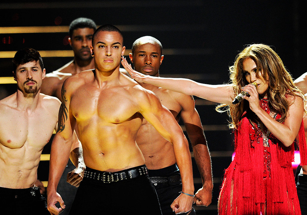 J Lo was surrounded by her sexy, and shirtless, dancers.
