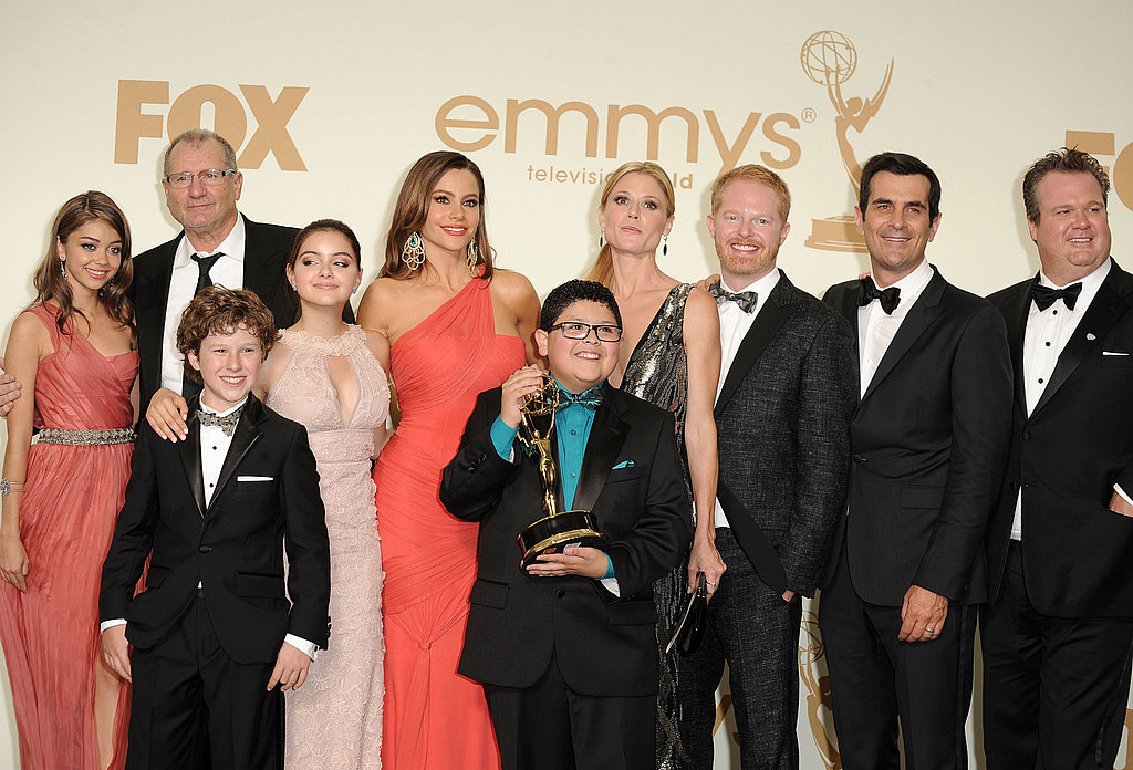 Sarah Hyland, Sofia Vergara, Julie Bowen, Ty Burrell, Jesse Tyler Ferguson, Ed O'Neill, Nolan Gould, and Ariel Winter in the Emmys press room.