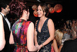 Emily Blunt and Megan Mullally laugh together.