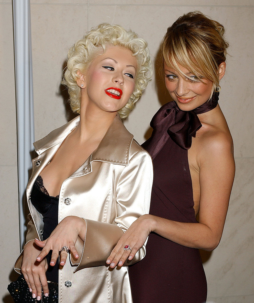 Nicole Richie and Christina Aguilera showed off their engagement rings during a February 2005 bash at Roberto Cavalli's Beverly Hills store.