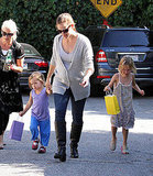 Seraphina Affleck holds hands with Jennifer Garner as they go to a party with Violet Affleck.