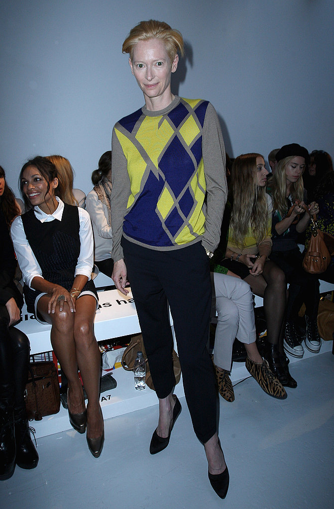 Tilda Swinton attended the Pringle of Scotland show wearing a modern argyle print sweater and black trousers.