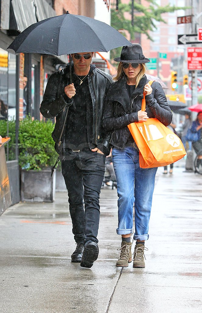 Jennifer Aniston and Justin Theroux brave the rain.